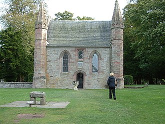 Scone Abbey - Replica of the Stone of Destiny in front of a 19th-century Presbyterian mortuary chapel on Moot Hill