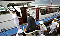 Secretary of Defense Leon E. Panetta, center, back to camera, boards U.S. Navy Adm. Cecil Haney's boat after visiting the USS Arizona Memorial in Pearl Harbor, Hawaii, March 9, 2012 120309-D-NI589-074.jpg