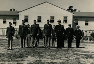 Civil Affairs Staging Area -  CASA Commander - Army Colonel Hardy C. Dillard  (center) stands to the left of CASA Deputy Commander -  Navy Captain William S. Veeder and alongside other senior Army /  Navy officers. Under a Joint Chiefs of Staff directive, CASA was created as a combined Army / Navy formation with Army personnel comprising 75% of all personnel.