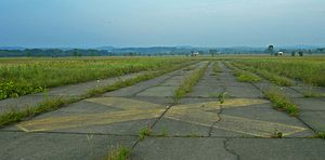 Shawangunk Grasslands National Wildlife Refuge - Abandoned runway, already slowly returning to grassland. Yellow cross indicates to aircraft that the airport is officially closed.