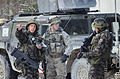 Slovenian soldiers discuss a status report with a U.S. Soldier, center, with the 2nd Cavalry Regiment during a mission rehearsal exercise (MRE) at the Grafenwoehr Training Area in Grafenwoehr, Germany, March 14 130314-A-GM460-004.jpg