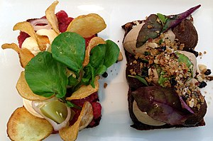 Open sandwich - Smørrebrød with green and red salad, chicken liver and tartar sauce