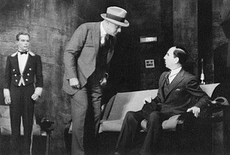 Robert Middlemass - Robert Middlemass (center) as Captain Seaver of the New York police, grilling a suspect in Small Miracle (1934)
