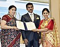 Smriti Irani presenting the Rajat Kamal Award to Rukshana Tabassum (Special Mention) for the Non-Feature film – THE CAKE STORY, at the 65th National Film Awards Function, in New Delhi.JPG