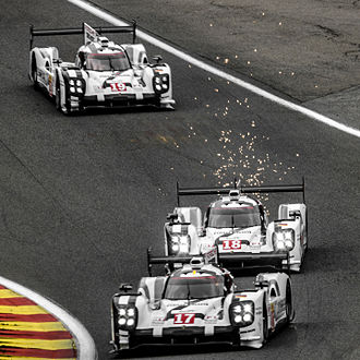 Porsche in motorsport - The 3 2015 Porsche 919 Hybrid LMP1 cars from Porsche LMP Team entering Raidillon at the 2015 WEC 6 Heures de Spa-Francorchamps.
