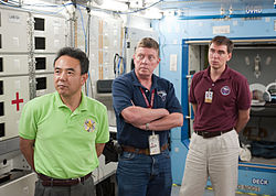 Soyuz TMA-02M Crew during a training at Johnson Space Center.jpg