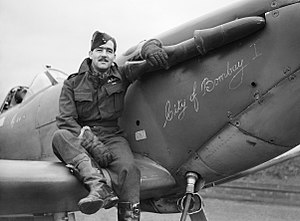 No. 122 Squadron RAF - Squadron Leader H J L Hallowes, CO of No. 122 Squadron, with his Supermarine Spitfire Mk V at RAF Scorton in Yorkshire, December 1941