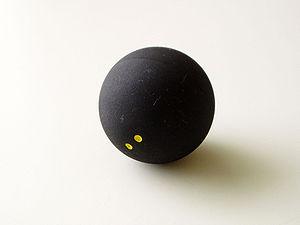 A double yellow squash ball.