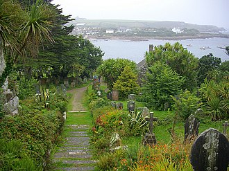 Old Town, Isles of Scilly - View of Old Town and the bay from the terraced graveyard; it is the resting place of many of those who have died in nearby shipwrecks.