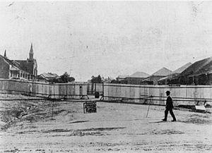 Holy Trinity Anglican Church, Woolloongabba - Quarantine barricade around houses in Hawthorne Street, Woolloongabba, Brisbane, Queensland, 1900