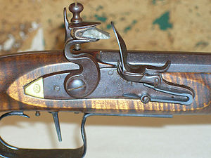 Knapping - A gun-flint mounted in the jaws of a flintlock musket