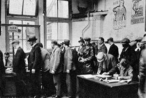Great Depression in the Netherlands - A line of unemployed people in Amsterdam, 1933.