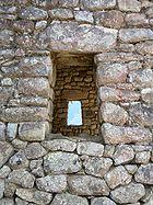 Detalle arquitectónico de una ventana en Machu Pichu.