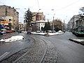 Streetcar tracks go down a narrow one-way street in Bucuresti.jpg