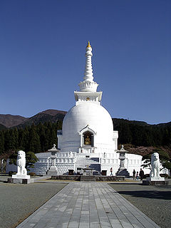 Stupa mound-like structure containing Buddhist relics, typically the ashes of Buddhist monks, used by Buddhists as a place of meditation