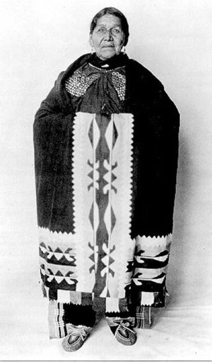 Lenape - Susie Elkhair (d. 1926) of the Delaware Tribe of Indians, wearing ribbonwork shawl.
