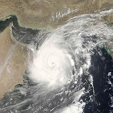 Satellite image of Cyclone Gonu near the coast of Oman, a country in the southeastern portion of the Arabian Peninsula