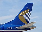 Tailfin of Midwest Airline Embraer 190AR (N171HQ).jpg