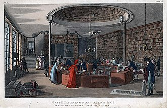 """James Lackington - Interior of the Temple of the Muses, showing the circular counter and space large enough for """"a mail-coach and four"""" to drive around it."""