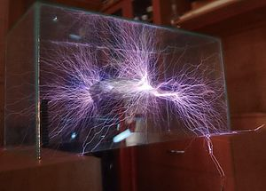 Streamer discharge - This time exposure of streamers from a Tesla coil in a glass box shows their filamentous nature.