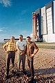 The Apollo 8 prime crew stands in foreground as the Apollo space vehicle.jpg