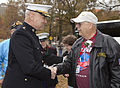 The Assistant Commandant of the Marine Corps, Gen. John M. Paxton, Jr., left, greets an Air Force veteran during an Honor Flight event at the Marine Corps War Memorial in Arlington, Va., Sept 131112-M-KS211-004.jpg