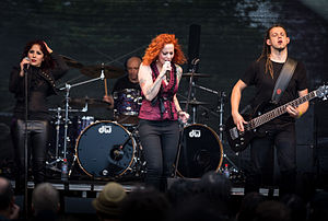 The Gentle Storm - The Gentle Storm live at the 2015 Wacken Open Air. From left to right: Marcela Bovio, Ed Warby, Anneke van Giersbergen and Johan van Stratum