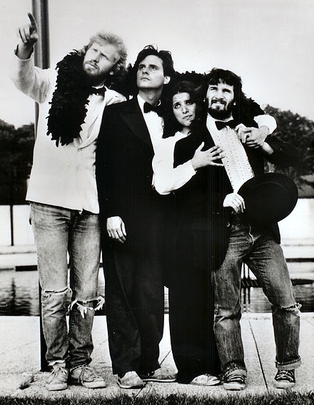 "Louis-Dreyfus as a part of The Practical Theatre Company's ""Golden 50th Anniversary Jubilee"" in 1982, alongside cast mates Brad Hall, Gary Kroeger and Paul Barrosse The Golden Jubilee (1982).jpg"