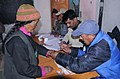 The Polling official administering indelible ink at the finger of a elderly woman voter at a polling booth near Thiksey Monastery in Ladakh during the 5th and final phase of General Election-2009, in J&K on May 13, 2009.jpg