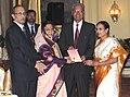 The President, Smt. Pratibha Devisingh Patil receiving a copy of book entitled 'Wisdom for Happy Life' from Dr. D.S. Rathore, at Rashtrapati Bhavan, in New Delhi on November 10, 2010.jpg