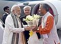 The Prime Minister, Shri Narendra Modi being welcomed by the Governor of Uttarakhand, Dr. Krishan Kant Paul and the Chief Minister of Uttarakhand, Shri Trivendra Singh Rawat, on his arrival, at Dehradun, in Uttarakhand.jpg