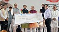The Union Home Minister, Shri Rajnath Singh presenting the cheques to the winners of logo and motto competitions, during the launch of the Student Police Cadet (SPC) programme for nationwide implementation, in Gurugram.JPG