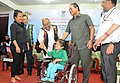 The Union Minister for Social Justice and Empowerment, Shri Thaawar Chand Gehlot distributing the Aids & Appliances to the Person with Disabilities (Divyangjan), in Aizawl (1).jpg