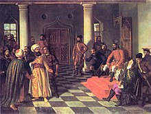 Two bearded men, each wearing a turban, stand before a man who sits on a throne; a dozen people surround them