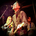 Tom Greenhalgh performing with the Mekons at the Hideout on July 11, 2015.jpg