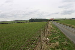 View of farm buildings and agricultural fields in Thwing and Octon parish