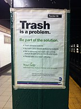 "An image of a notice on a metal support beam in the subway. The notice reads ""Trash is a problem. Be part of the solution. Trash attracts rodents. No trash cans means no food for rodents. We're removing the trash cans at this station as part of a six month pilot study. Please take your trash with you. Your help will make this station cleaner and greener. Visit mta.info to tell us what you think of this pilot currently in effect at ten stations."""