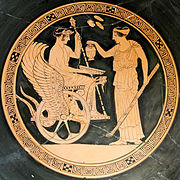 Triptolemos sits in the winged chariot drawn by serpents and accepts moisture given by Persephone, tondo of a red-figure cup by the Aberdeen Painter, (Louvre)