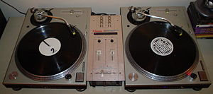 Turntablism - A DJ vinyl turntable system, consisting of two turntables and a crossfader-equipped DJ mixer.