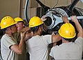 U.S. Air Force Airman Christian Botello, Airman Justin Trathen, Airman Samuel Kwon and Staff Sgt. Justin Boyd, an instructor, all in the jet propulsion course with the 361st Training Squadron, install 130827-F-NS900-006.jpg