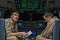 U.S. Air Force Capt. Robert Hutsell, left, and Jacob Arndt, both C-17 Globemaster III aircraft pilots with the 816th Expeditionary Airlift Squadron, conduct a preflight briefing inside the cockpit of their 130110-F-PM120-297.jpg