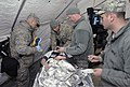 U.S. Airmen assigned to the Chemical, Biological, Radiological, Nuclear and high-yield Explosives Enhanced Response Force Package, Oregon Air National Guard treat a simulated victim near Joint Base 140327-Z-CH590-475.jpg