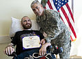 U.S. Army Gen. John F. Campbell, right, the vice chief of staff of the Army, presents a Purple Heart award to Staff Sgt. Cody Ensley at the San Antonio Military Medical Center at Joint Base San Antonio-Fort Sam 140103-A-JW984-024.jpg