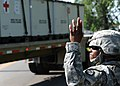 U.S. Army Sgt. Essence Johnson, assigned to the 565th Quartermaster Company, marshals an M1088 tractor truck at the Indiana National Guard Armory in Scottsburg, Ind 120802-F-HS649-126.jpg