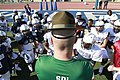 U.S. Marine Corps Sgt. Brian Craddock, a drill instructor assigned to Marine Corps Recruit Depot, San Diego, speaks with players of the Semper Fidelis All-American East Team at Fullerton College in Fullerton 140102-M-QG862-017.jpg