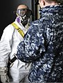 U.S. Navy Aviation Boatswain's Mate (Handling) 3rd Class Jon Socks, right, fastens Aviation Boatswain's Mate (Handling) 3rd Class Jamarr Reese into a safety harness aboard the aircraft carrier USS Nimitz (CVN 130128-N-TR165-007.jpg