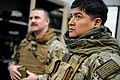 U.S. Navy Boatswain's Mate 1st Class Eddie Montalvo, right, and Electronics Technician 1st Class Garrett Swanson, both assigned to Commander, Task Force (CTF) 56, don body armor for weapons training at Naval 140212-N-OU681-220.jpg