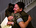 U.S. Navy Hospital Corpsman 2nd Class Anastatia M. Dobbs, right, with Black Sea Rotational Force 11, hugs her shipmate, Hospital Corpsman 2nd Class Julissa Flores, after taking an oath of U.S. citizenship 110712-M-OB762-002.jpg