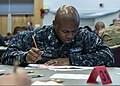 U.S. Navy Ship's Serviceman 1st Class Antonio Jordan takes the chief petty officer advancement exam aboard the aircraft carrier USS Nimitz (CVN 68) 130117-N-FX989-006.jpg