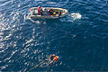 U.S. Sailors assigned to the guided missile destroyer USS Truxtun (DDG 103) participate in search and rescue training during a simulated man overboard drill Dec. 6, 2013, in the Atlantic Ocean 131206-N-EI510-068.jpg